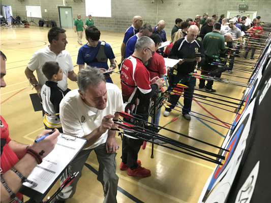 Archers scoring at an indoor shoot